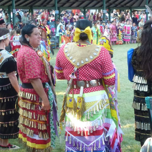 Lori on right with Jingle Dancers