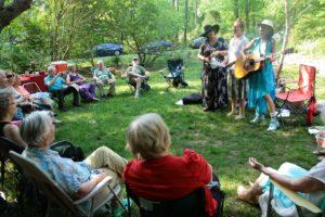 women singing at Temenos Garden