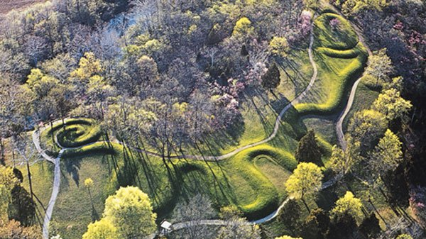 Web arial photo of Serpent Mound, the largest effigy mound, undulating along a ridge.