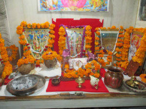 Altar for Dwali in India covered with orange marigold flowers