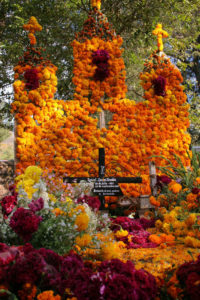 Day of the Dead altar with orange marigolds